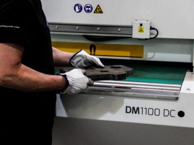 Deburring machine plasma cut part feeding into machine