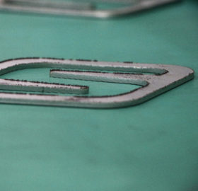 metal part cut by laser for deburring process